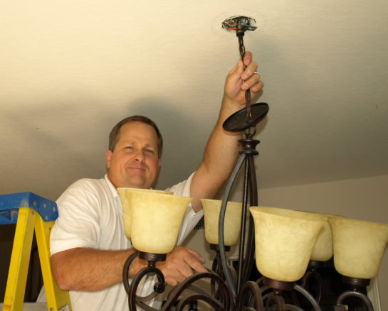 Lighting Agoura Electrical Contractor Installing Chandelier